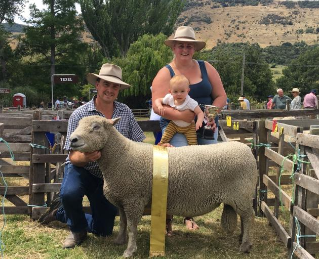 John and Stacey Burrows of Burrows Genetics, from Oxford with their supreme champion sheep